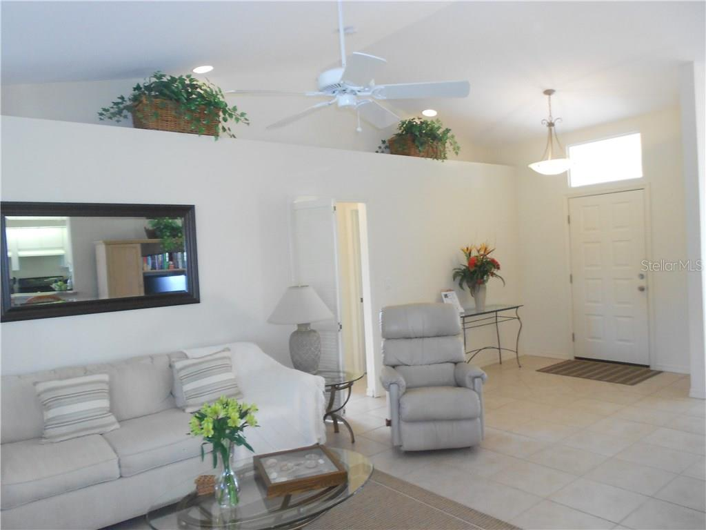 Foyer and Great Room - Single Family Home for sale at 6320 Hera St, Englewood, FL 34224 - MLS Number is A4200968