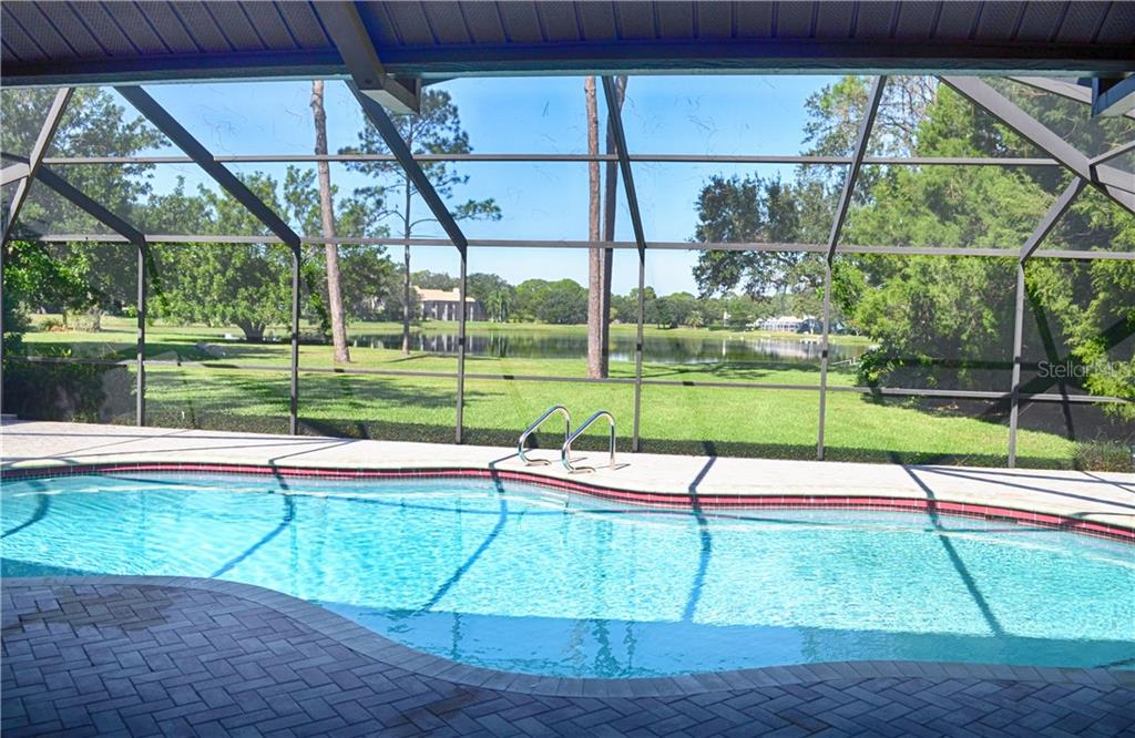 large pool/spa with brand new pavered deck, beautiful view of the large lake - Single Family Home for sale at 7529 Weeping Willow Blvd, Sarasota, FL 34241 - MLS Number is A4201676