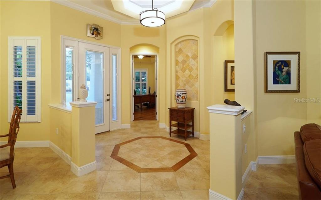Foyer entryway with floor and ceiling details - Single Family Home for sale at 1746 Hillview St, Sarasota, FL 34239 - MLS Number is A4202985