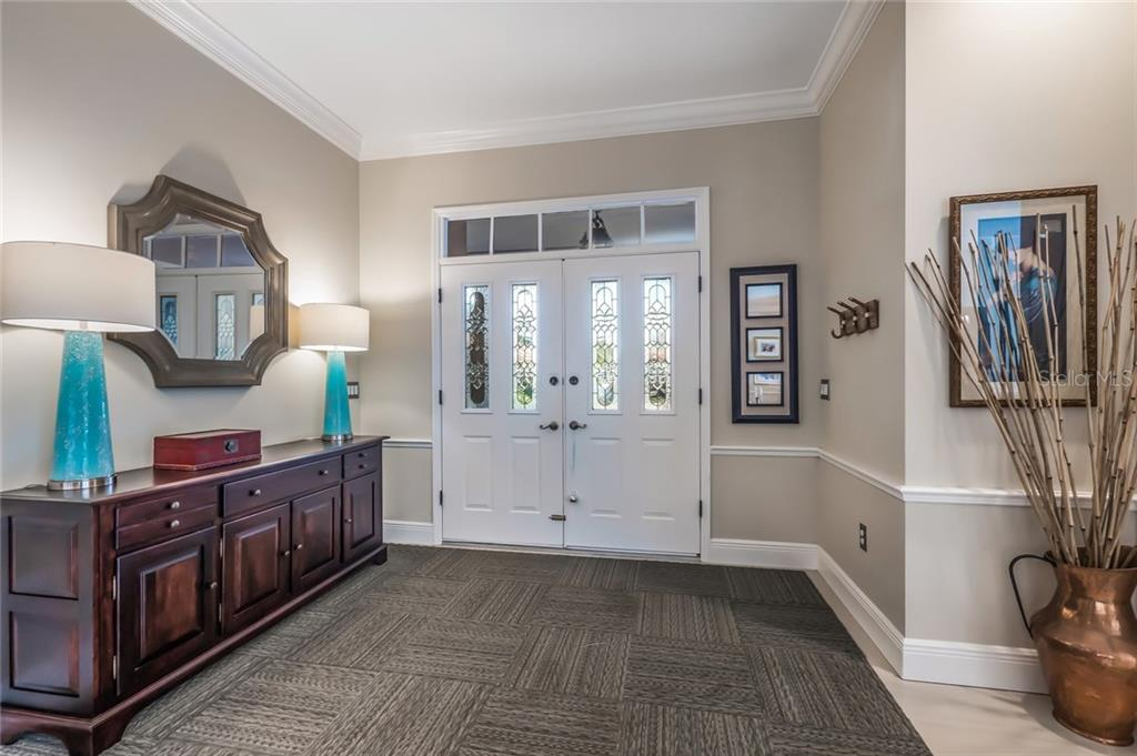Entry Foyer - Single Family Home for sale at 5026 Kestral Park Way S, Sarasota, FL 34231 - MLS Number is A4203689