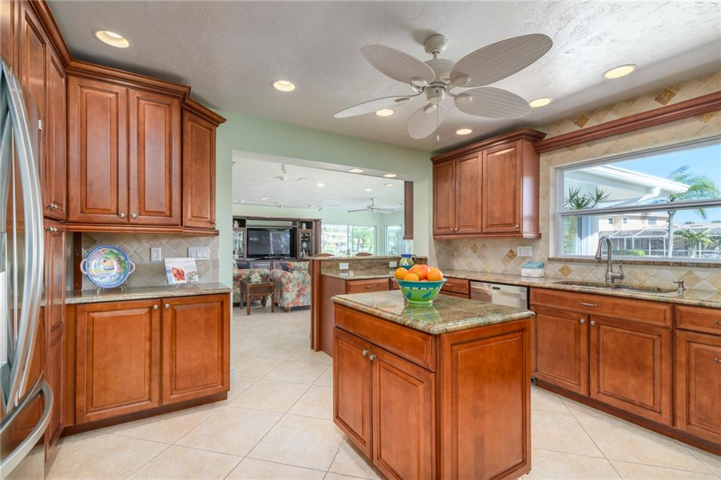 Kitchen view into family room - Single Family Home for sale at 5439 Azure Way, Sarasota, FL 34242 - MLS Number is A4203969