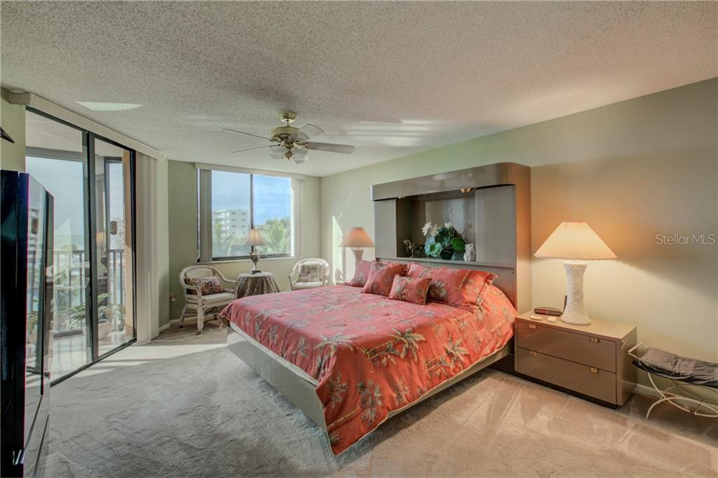 master bedroom with sliders to lanai - Condo for sale at 5880 Midnight Pass Rd #610, Sarasota, FL 34242 - MLS Number is A4204670