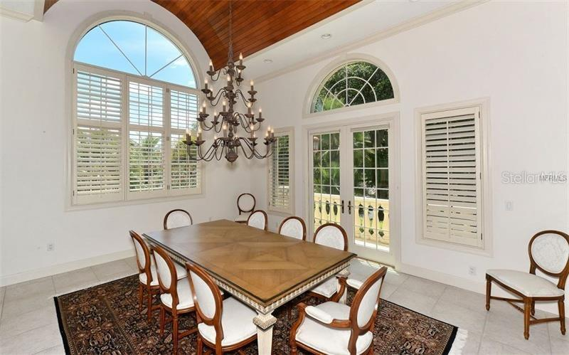 Formal dining with barrel, wood plank ceiling. - Single Family Home for sale at 1630 Harbor Sound Dr, Longboat Key, FL 34228 - MLS Number is A4204745