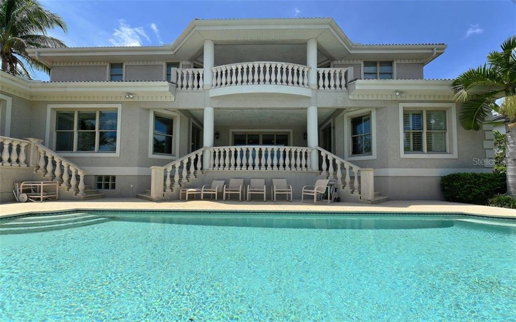 Rear exposure. Pool with abundant sun and shade. - Single Family Home for sale at 1630 Harbor Sound Dr, Longboat Key, FL 34228 - MLS Number is A4204745