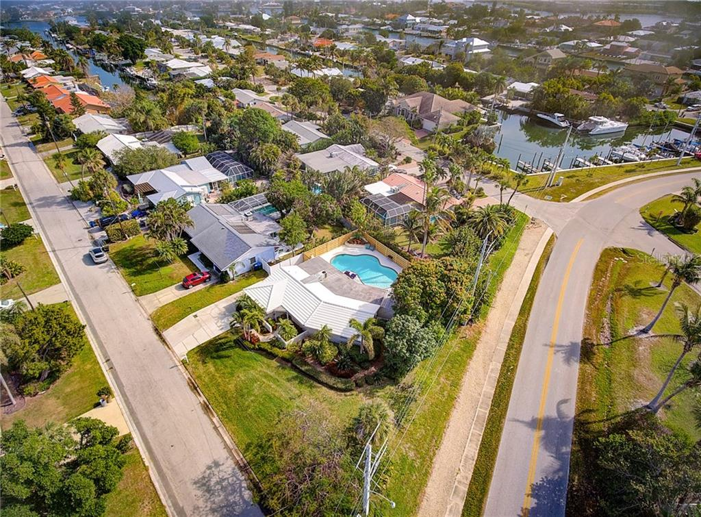 Aerial view of property situated on a corner lot. Boat slips are available on a first come, first served basis through the city of Holmes Beach! - Single Family Home for sale at 501 70th St, Holmes Beach, FL 34217 - MLS Number is A4205799