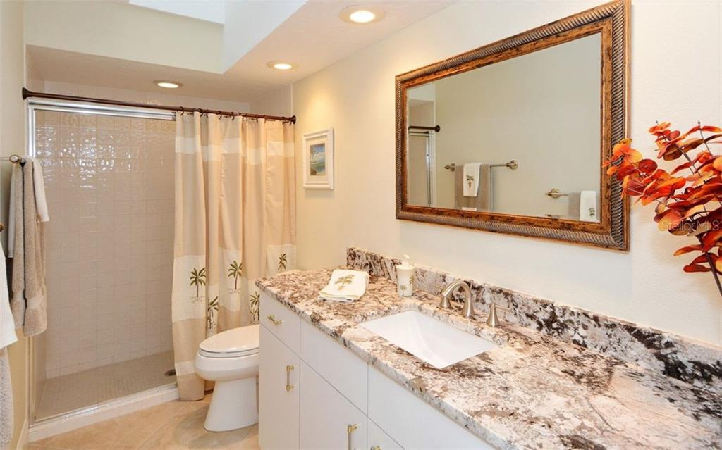 3rd full bath across from office for game room as well - Single Family Home for sale at 3882 Spyglass Hill Rd, Sarasota, FL 34238 - MLS Number is A4206477