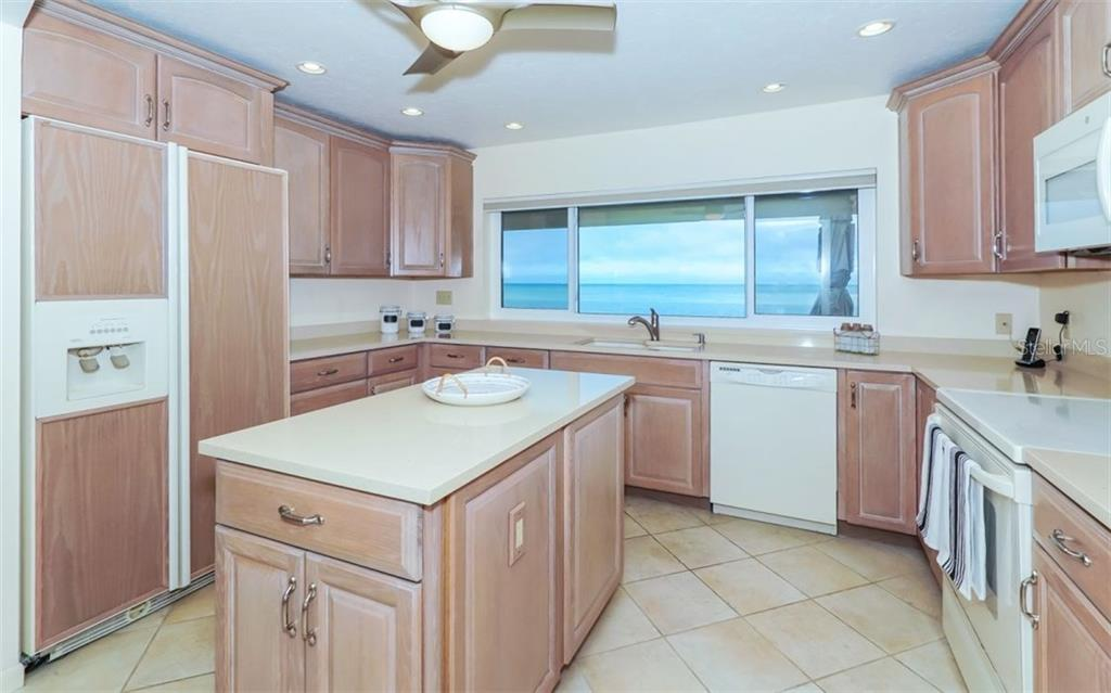 Kitchen with Gulf views - Single Family Home for sale at 148 Sand Dollar Ln, Sarasota, FL 34242 - MLS Number is A4206505