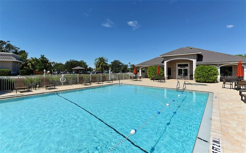 Stoneybrook Golf & Country Club heated community pool and fitness center entrance. - Villa for sale at 9554 Forest Hills Cir, Sarasota, FL 34238 - MLS Number is A4206506