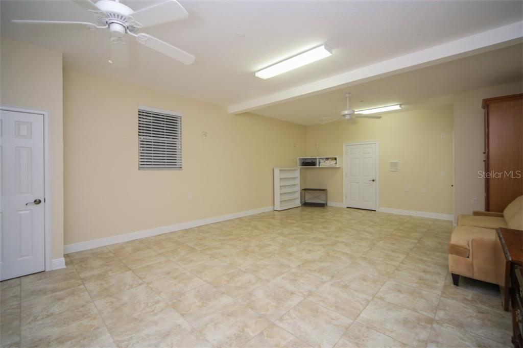 Very Large ground level home gym/play room/storage - Single Family Home for sale at 7047 Hawks Harbor Cir, Bradenton, FL 34207 - MLS Number is A4206626