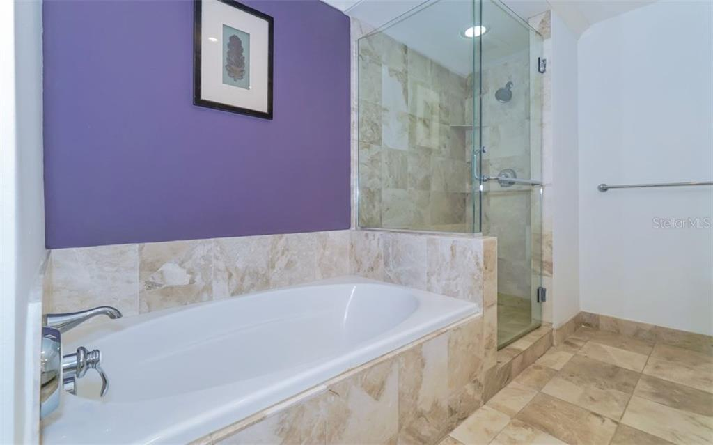 Master bath with soaking tub and separate shower stall - Condo for sale at 1350 Main St #608, Sarasota, FL 34236 - MLS Number is A4206707