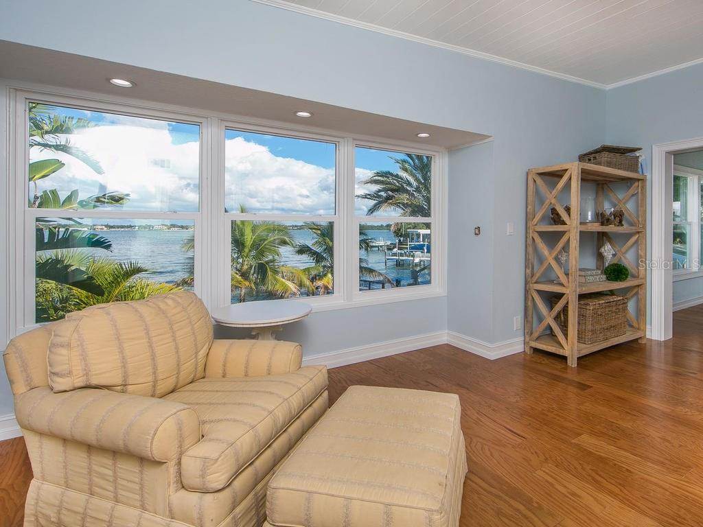 Master bedroom sitting area with gorgeous Intracoastal views - Single Family Home for sale at 8101 Midnight Pass Rd, Sarasota, FL 34242 - MLS Number is A4206718