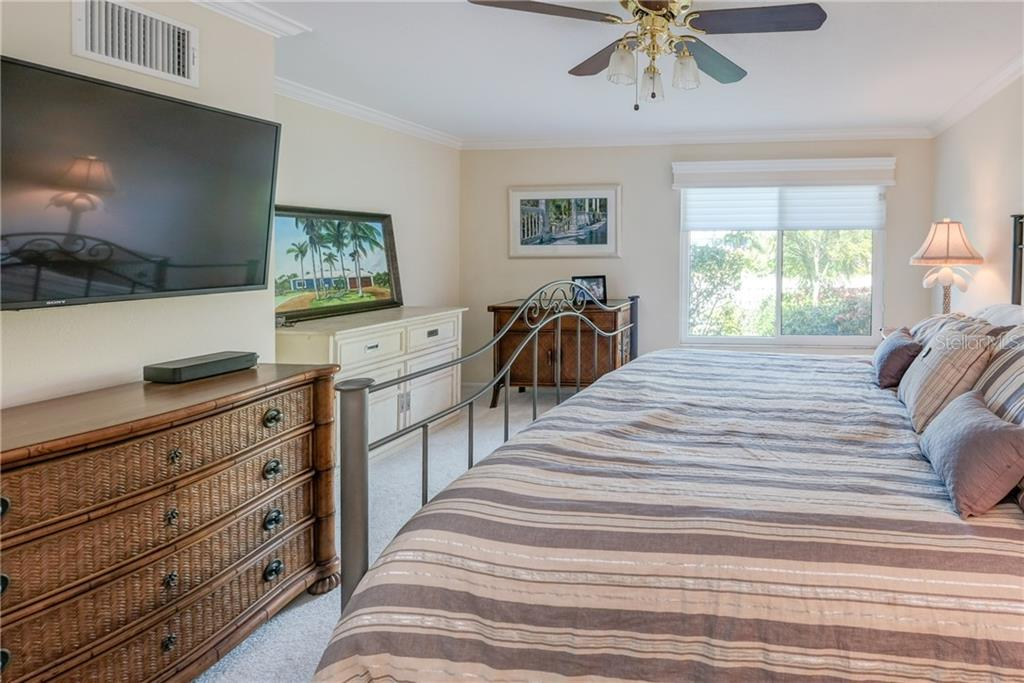 Spacious master bedroom looking to The Grand Canal. - Single Family Home for sale at 5633 Cape Leyte Dr, Sarasota, FL 34242 - MLS Number is A4207008