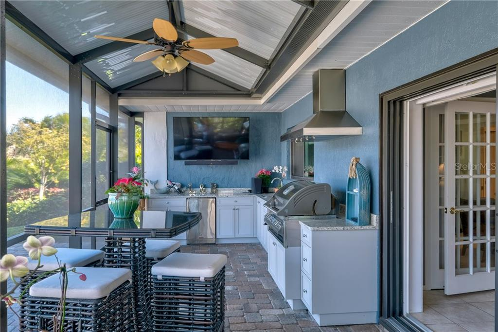 Fabulous outdoor kitchen off the family room, covered and screened. - Single Family Home for sale at 5633 Cape Leyte Dr, Sarasota, FL 34242 - MLS Number is A4207008