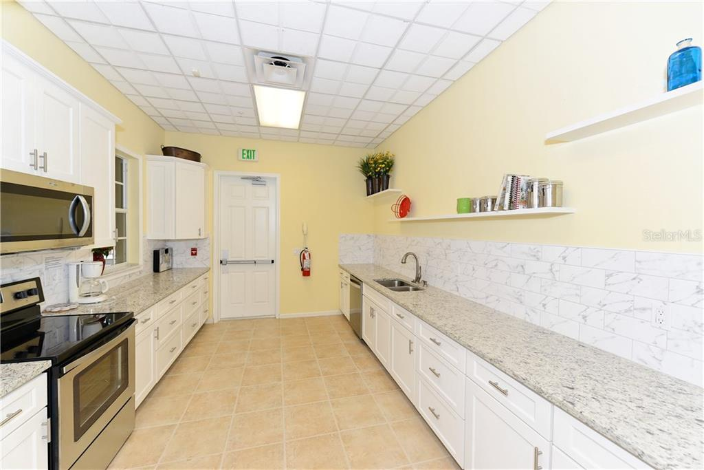 Community catering kitchen. - Condo for sale at 5242 Parisienne Pl #201bd30, Sarasota, FL 34238 - MLS Number is A4208770