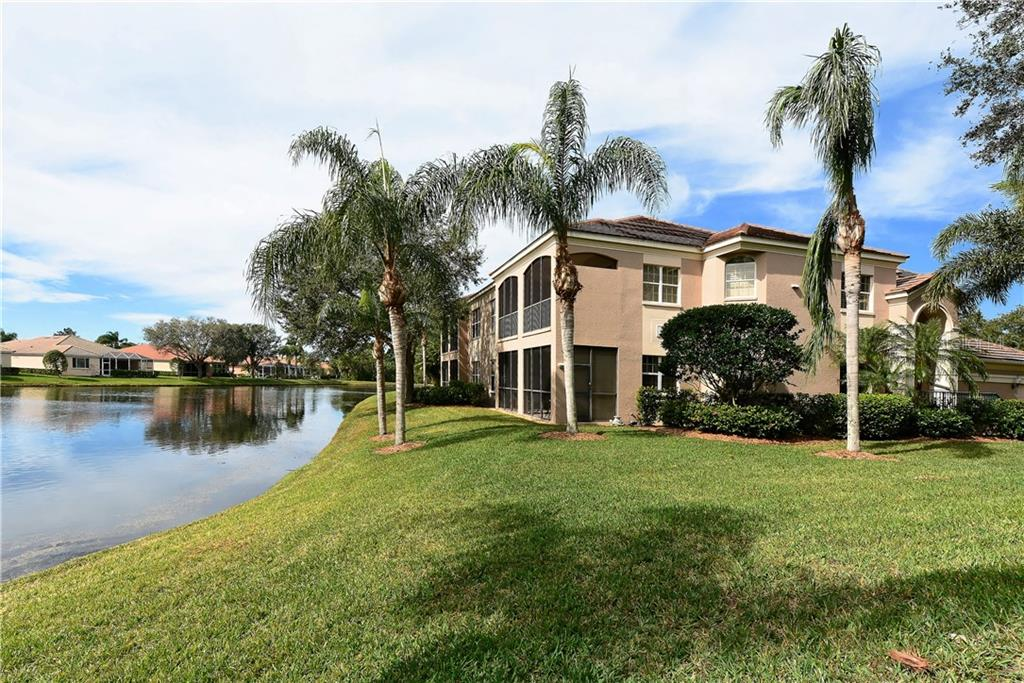 Backyard lake view. - Condo for sale at 5242 Parisienne Pl #201bd30, Sarasota, FL 34238 - MLS Number is A4208770