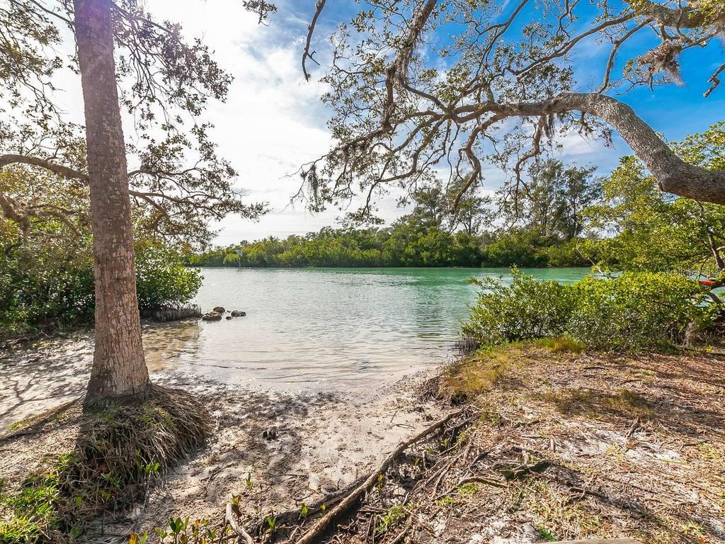 Community area - watch the sunset, launch your kayak...a short stroll from your front door! - Single Family Home for sale at 411 Lyons Bay Rd, Nokomis, FL 34275 - MLS Number is A4209146