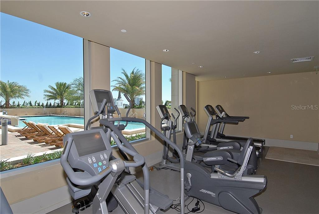 Exercise machines with pool view. - Condo for sale at 1350 Main St #1106, Sarasota, FL 34236 - MLS Number is A4209424