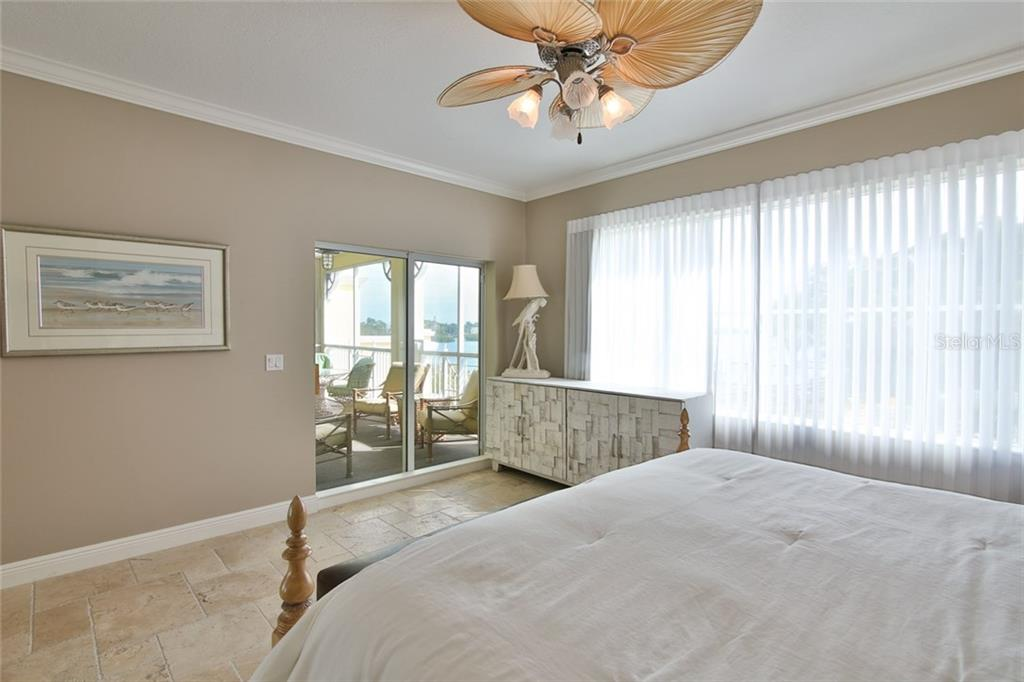 Master Bedroom-lots of natural light, water view and screened balcony - Condo for sale at 1310 Old Stickney Point Rd #e21, Sarasota, FL 34242 - MLS Number is A4209502