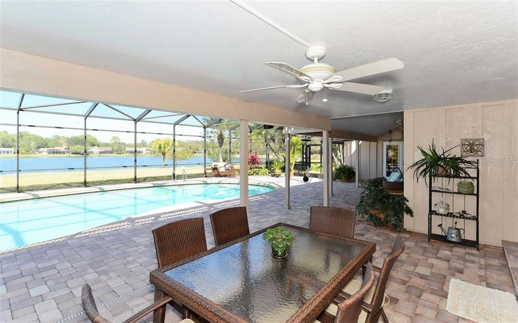 Dine al fresco, soak in the view and enjoy the Florida air. - Single Family Home for sale at 5122 Willow Leaf Dr, Sarasota, FL 34241 - MLS Number is A4209555