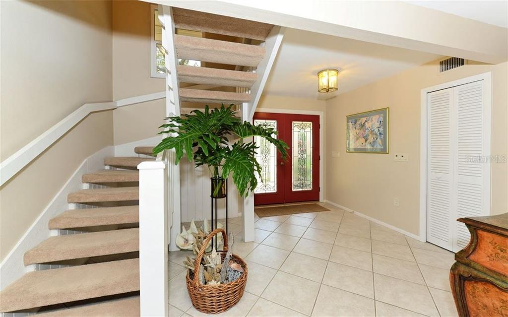 Double glass door entry leads to a large foyer. - Single Family Home for sale at 5122 Willow Leaf Dr, Sarasota, FL 34241 - MLS Number is A4209555