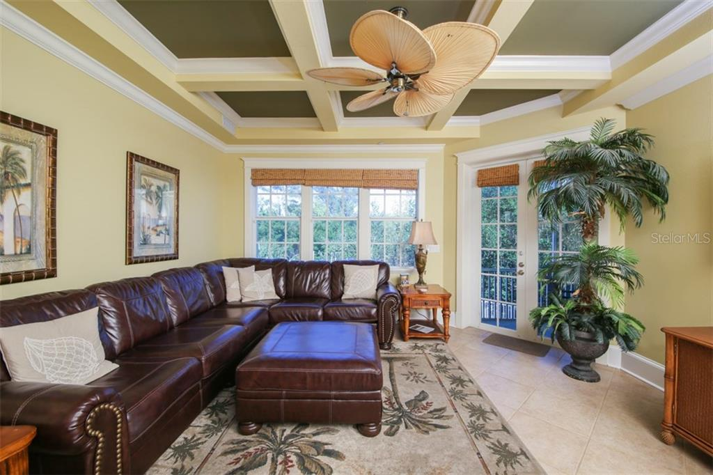 Great open living area off kitchen  - with balcony - Single Family Home for sale at 455 Canal Rd, Sarasota, FL 34242 - MLS Number is A4209817