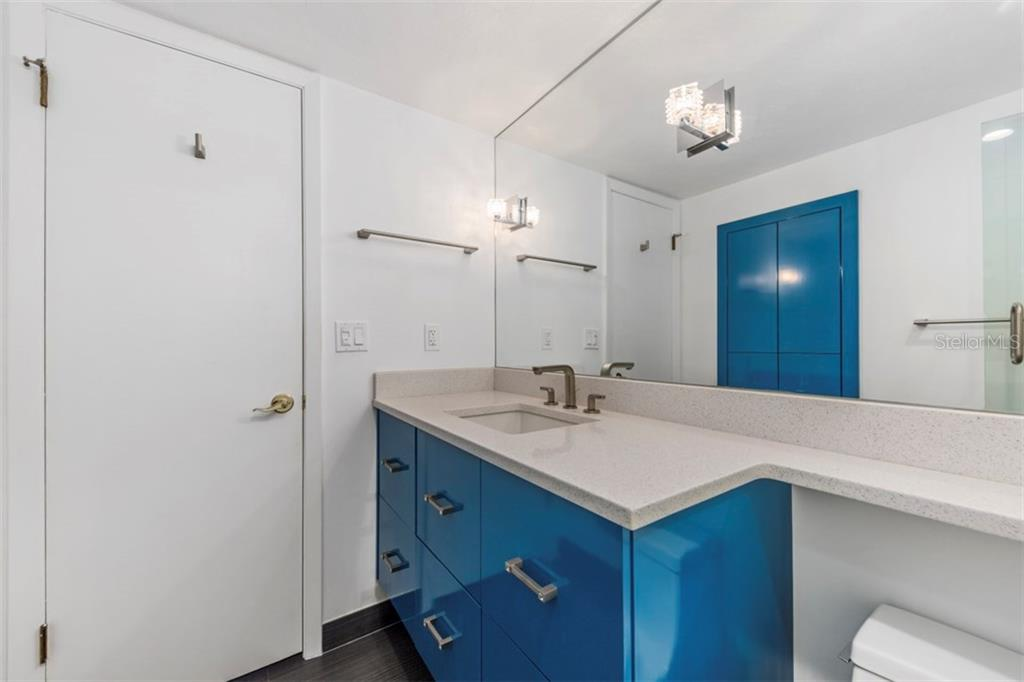 Spare bathroom completely remodeled with storage in the wall - Condo for sale at 6140 Midnight Pass Rd #608, Sarasota, FL 34242 - MLS Number is A4209897