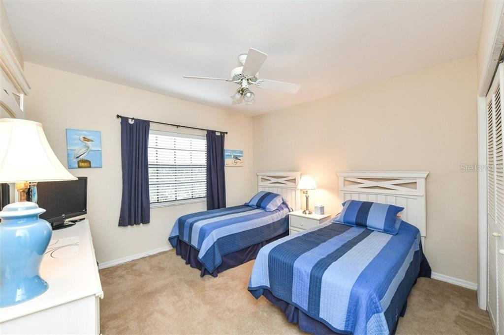 Bedroom 2-Nice size. - Single Family Home for sale at 7536 Weeping Willow Dr, Sarasota, FL 34241 - MLS Number is A4210209