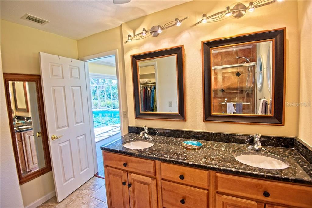 Master bathroom with dual sinks - Single Family Home for sale at 600 Wild Turkey Ln, Sarasota, FL 34236 - MLS Number is A4210585