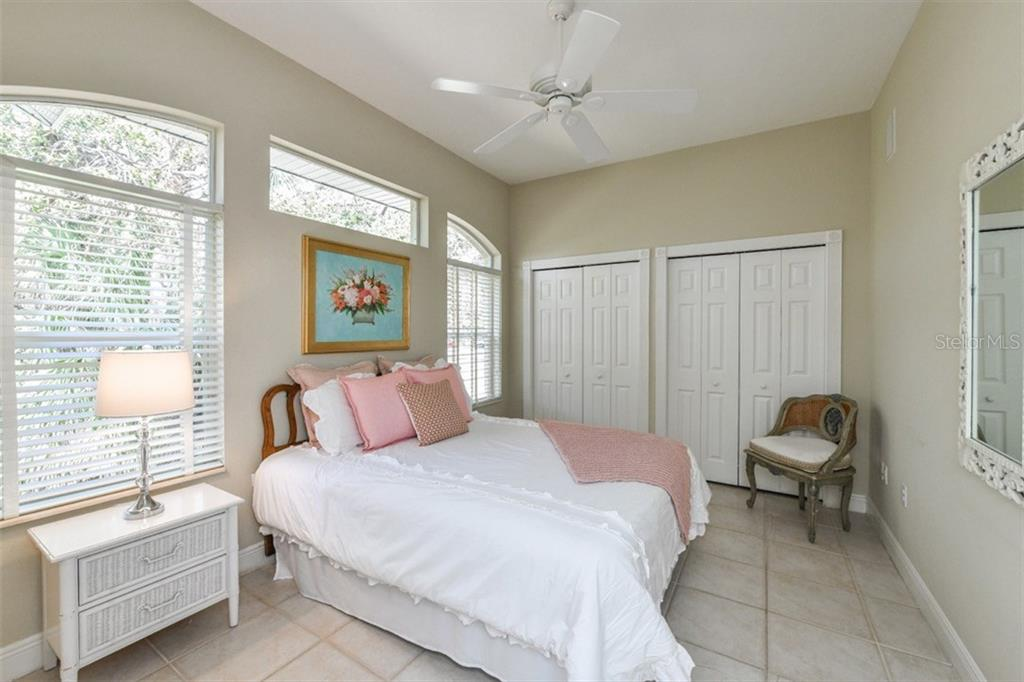 Bedroom #2 on the main level has its own full ensuite Bathroom and features a wall of closets. - Single Family Home for sale at 5585 Siesta Estates Ct, Sarasota, FL 34242 - MLS Number is A4211109