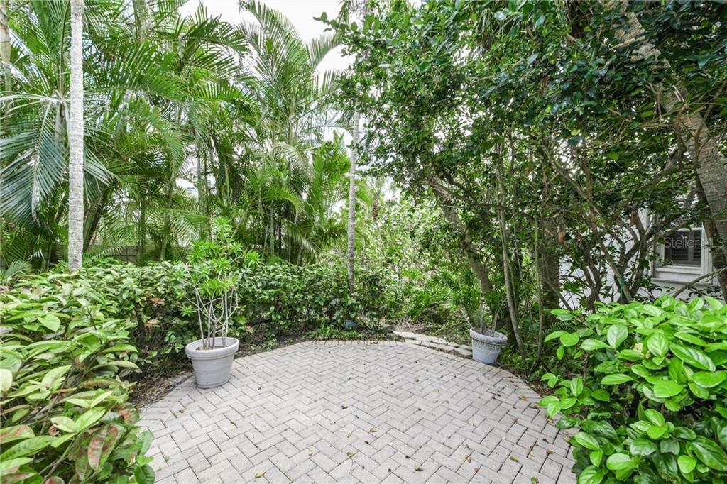 Brick patio beside the pool is a great area for grilling. - Single Family Home for sale at 5585 Siesta Estates Ct, Sarasota, FL 34242 - MLS Number is A4211109