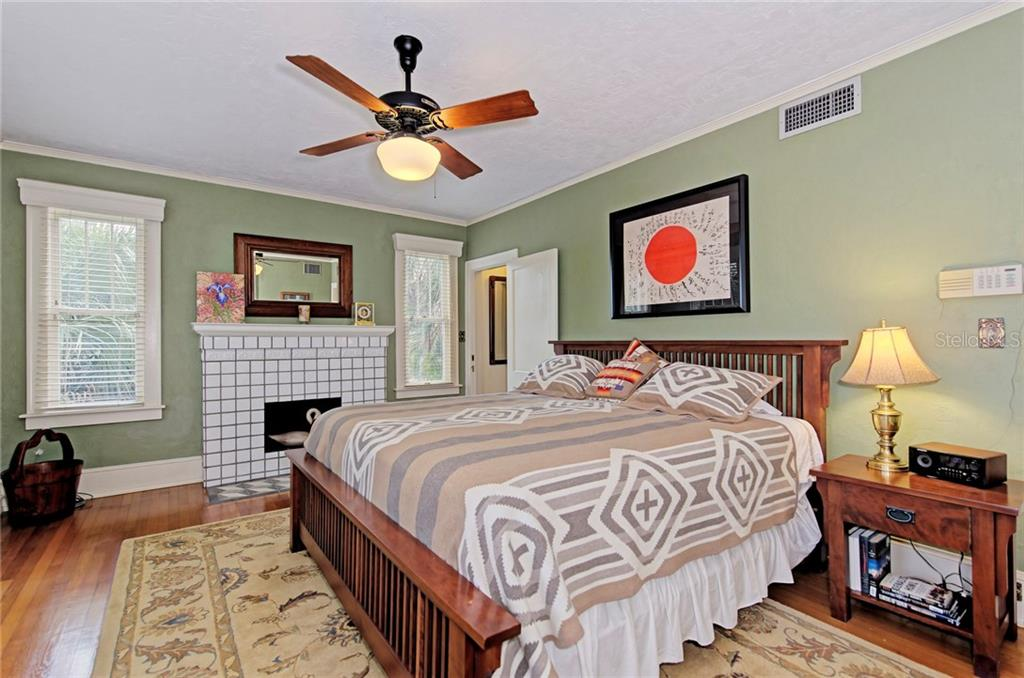 Master bedroom with wood burning fireplace - Single Family Home for sale at 1874 Wisteria St, Sarasota, FL 34239 - MLS Number is A4211659