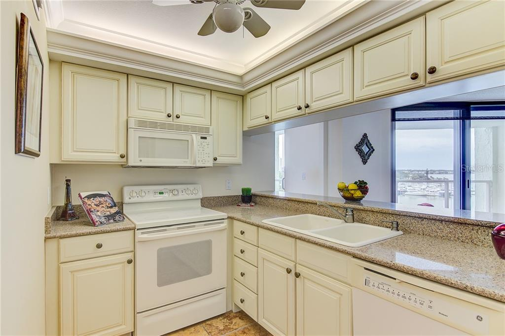 Master Bedroom Overlooking Marina Jacks (Photos are Virtually Staged) - Condo for sale at 1111 N Gulfstream Ave #7b, Sarasota, FL 34236 - MLS Number is A4212040