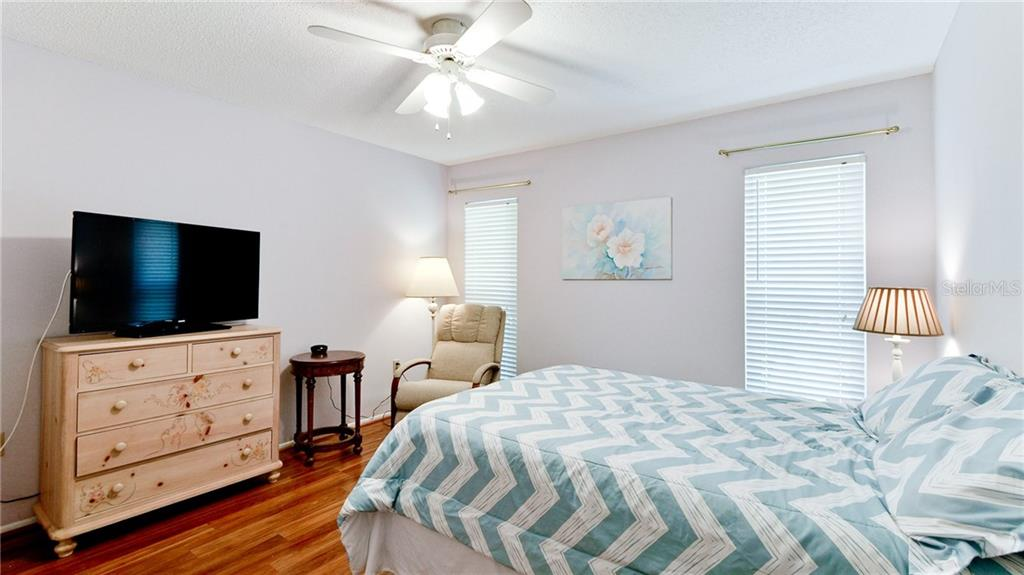 2nd bedroom with wood laminate flooring. - Condo for sale at 5107 29th St W #n/A, Bradenton, FL 34207 - MLS Number is A4213034