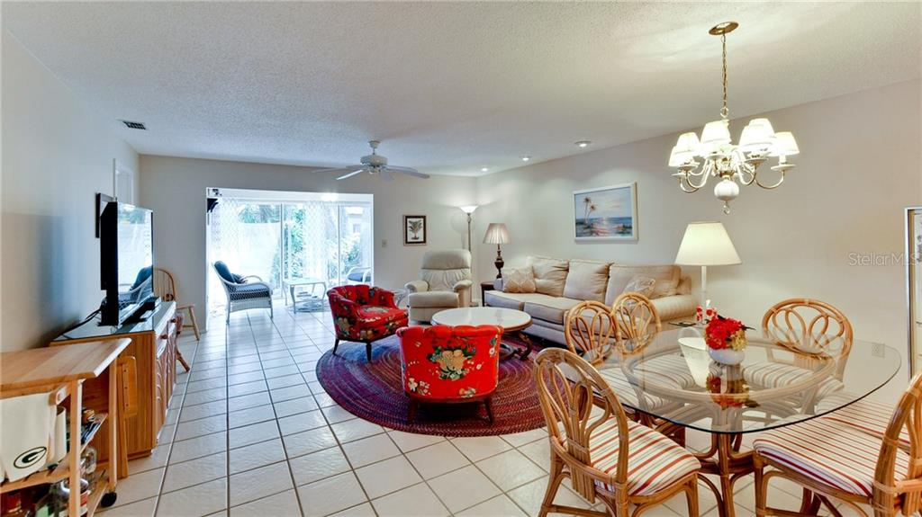 Looking out from living room to enclosed lanai. - Condo for sale at 5107 29th St W #n/A, Bradenton, FL 34207 - MLS Number is A4213034