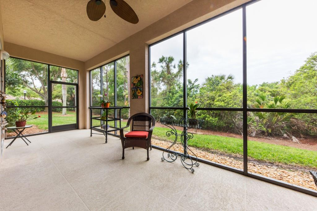 Large Lanai overlooking preserve provides privacy - Condo for sale at 7504 Botanica Pkwy #101, Sarasota, FL 34238 - MLS Number is A4213208