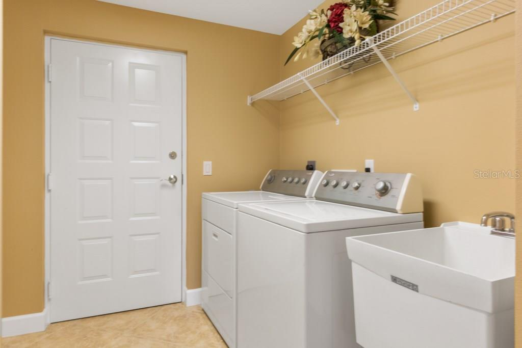 The interior Utility Room opens into the 2-car garage. - Condo for sale at 7504 Botanica Pkwy #101, Sarasota, FL 34238 - MLS Number is A4213208