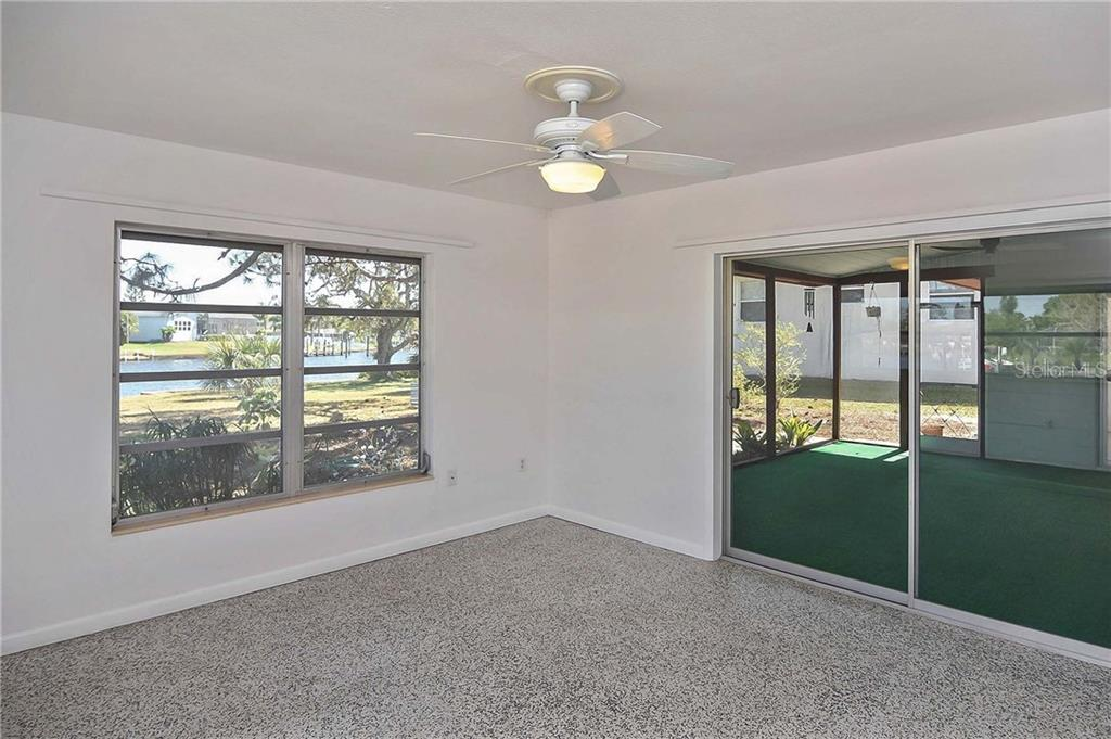 Master bedroom with sliders to covered lanai - Single Family Home for sale at 1953 Fairview Dr, Englewood, FL 34223 - MLS Number is A4213338