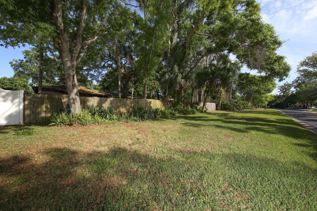The property includes the land between the fence and the road to the south of the home. - Single Family Home for sale at 4417 Garcia Ave, Sarasota, FL 34233 - MLS Number is A4213473