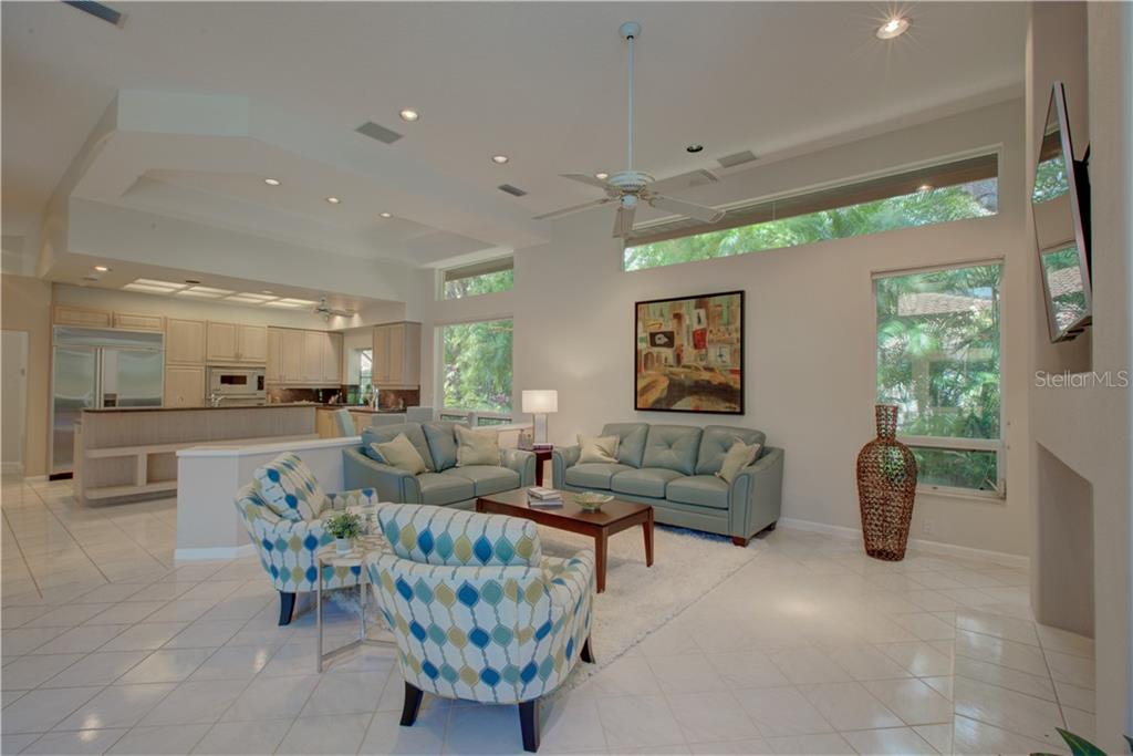 Wonderful Great Room with volume ceilings and large open windows and feature fireplace - Single Family Home for sale at 3896 Boca Pointe Dr, Sarasota, FL 34238 - MLS Number is A4213831