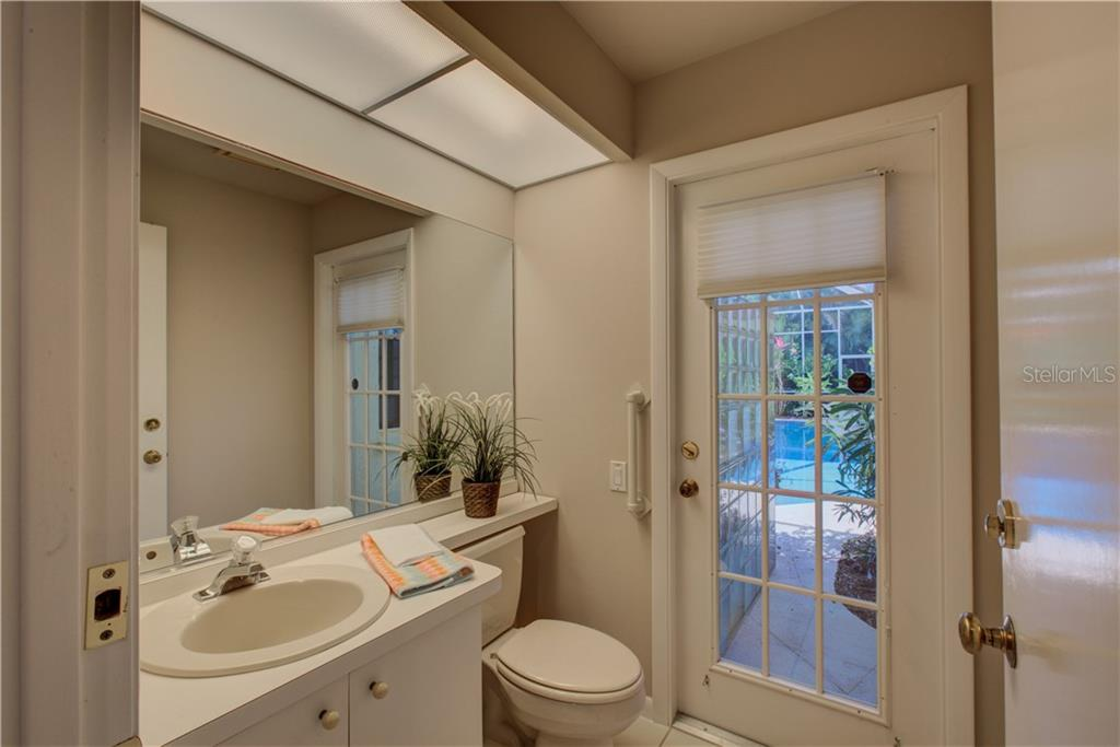 Guest half bath with access to the pool - Single Family Home for sale at 3896 Boca Pointe Dr, Sarasota, FL 34238 - MLS Number is A4213831