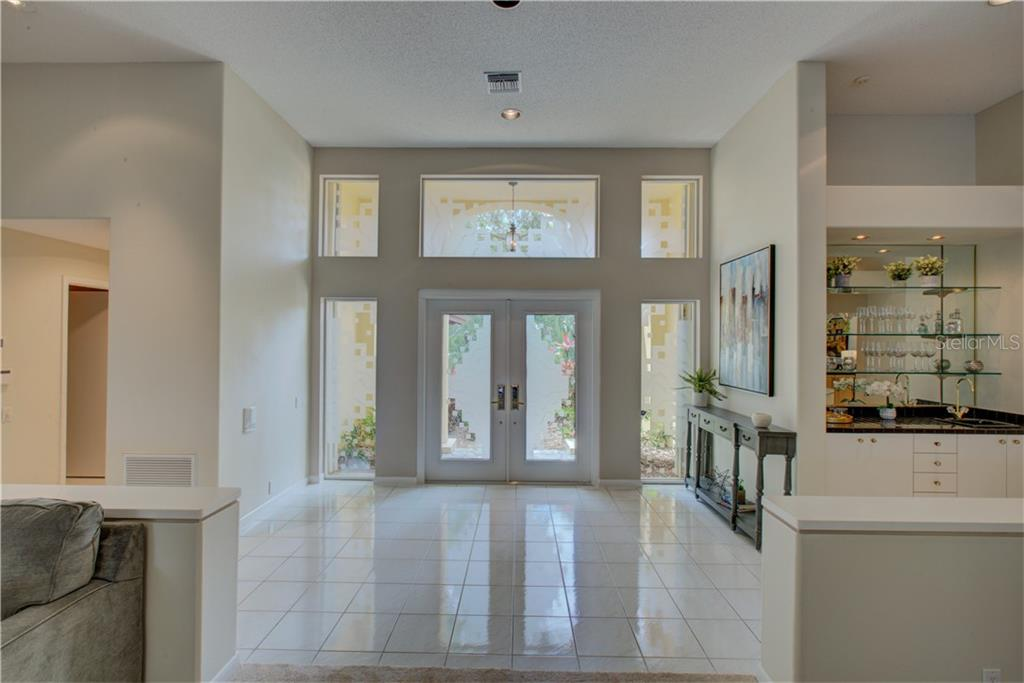 Elegant double door entryway allowing the natural sunlight to flow through. - Single Family Home for sale at 3896 Boca Pointe Dr, Sarasota, FL 34238 - MLS Number is A4213831