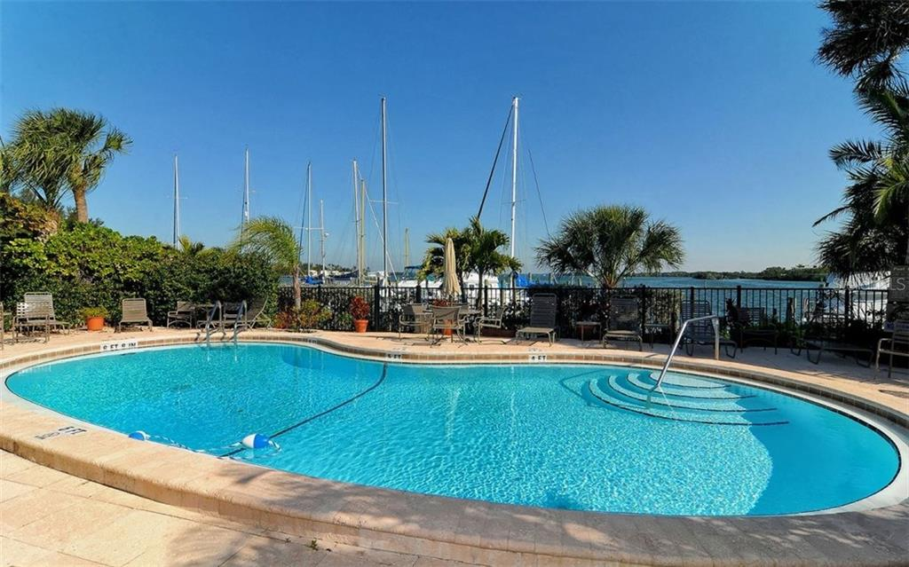 Community pool and hot tub - Condo for sale at 3440 Gulf Of Mexico Dr #8, Longboat Key, FL 34228 - MLS Number is A4214047