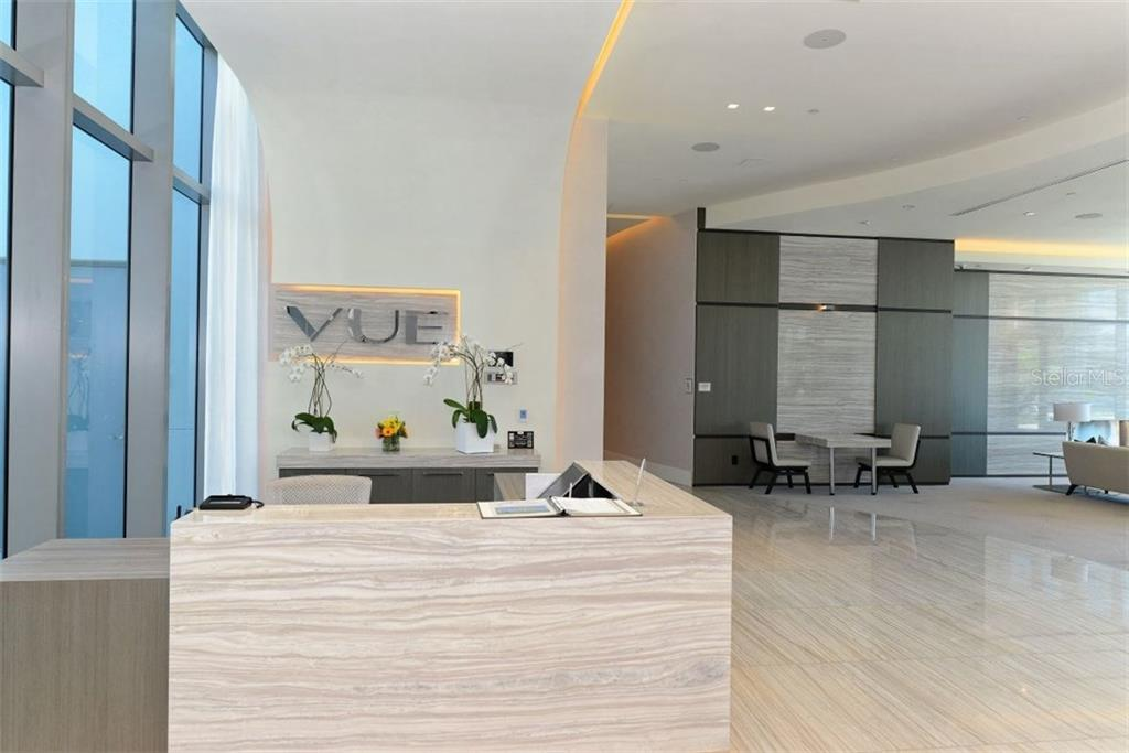 The reception desk in the lobby where your Concierge will look after you and your guests - Condo for sale at 1155 N Gulfstream Ave #1504, Sarasota, FL 34236 - MLS Number is A4215032