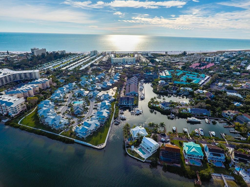 Private attached 1 car garage with storage above. - Condo for sale at 1215 Dockside Pl #204, Sarasota, FL 34242 - MLS Number is A4215997