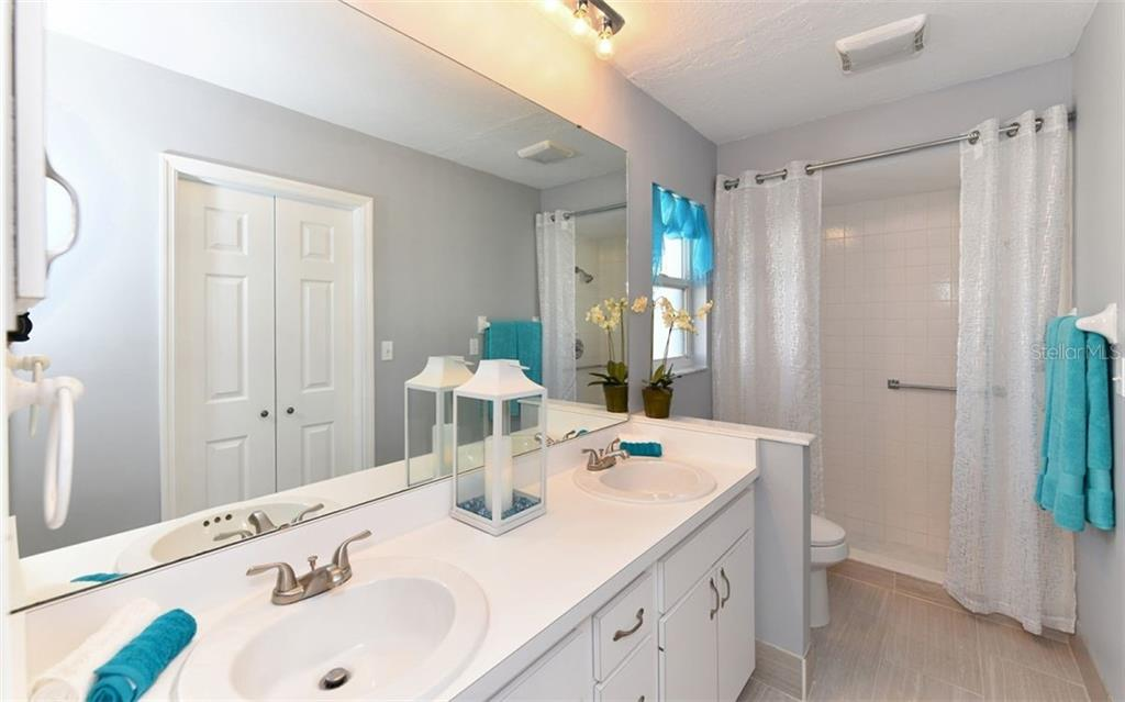 Master Bathroom with Dual Sinks, New Flooring & More! - Single Family Home for sale at 6202 65th Ct E, Palmetto, FL 34221 - MLS Number is A4400567