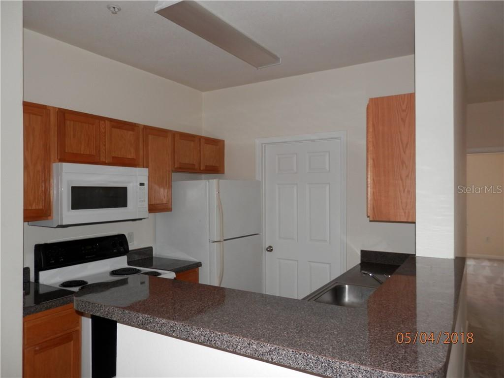 Kitchen - Condo for sale at 4802 51st St W #1318, Bradenton, FL 34210 - MLS Number is A4402353