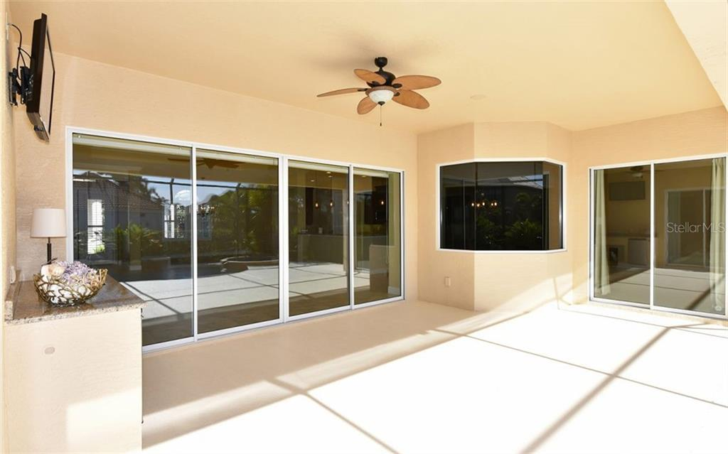 Pool with sun shelf & spa overlooking the canal. - Single Family Home for sale at 533 Mast Dr, Bradenton, FL 34208 - MLS Number is A4402963