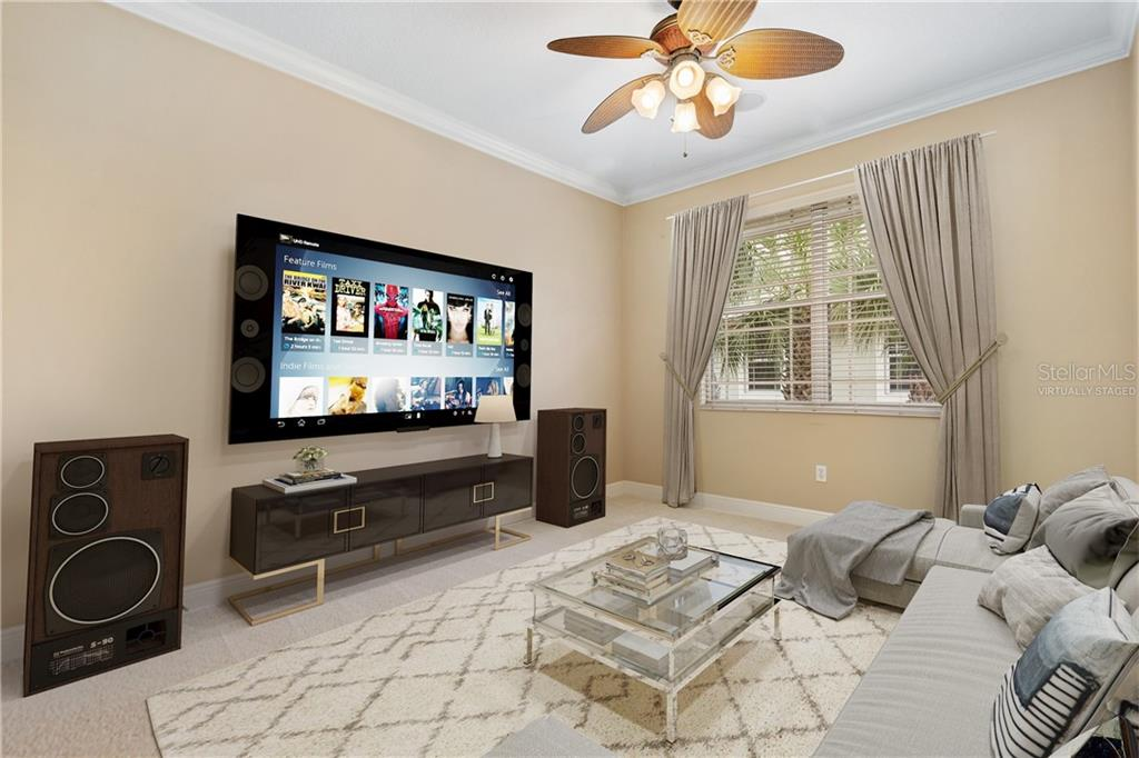 Virtually staged.  Flex room set up as media room or tv room. - Condo for sale at 6540 Moorings Point Cir #202, Lakewood Ranch, FL 34202 - MLS Number is A4403403