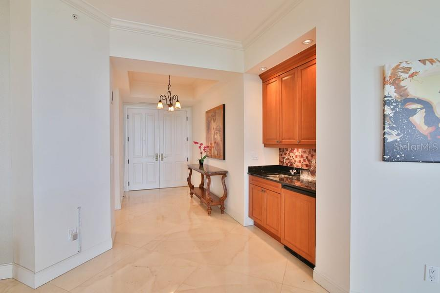 Entrance into the residence, built in wet bar. - Condo for sale at 1300 Benjamin Franklin Dr #507, Sarasota, FL 34236 - MLS Number is A4403882