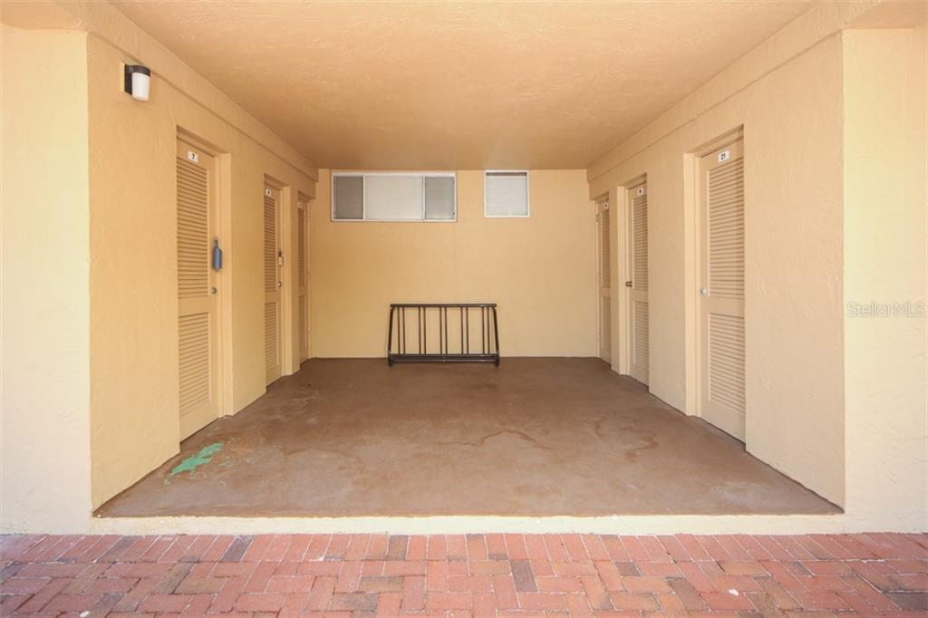 Storage room for Unit 101 is #7. Great for bikes and beach toys. - Condo for sale at 5200 Gulf Dr #101, Holmes Beach, FL 34217 - MLS Number is A4404016
